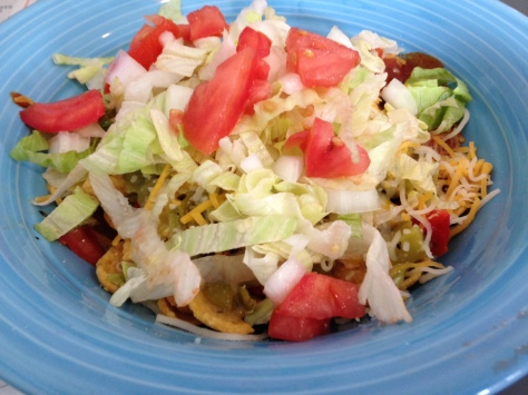 Frito Pie featuring Tia Betty Blue's red and green chile. YES.