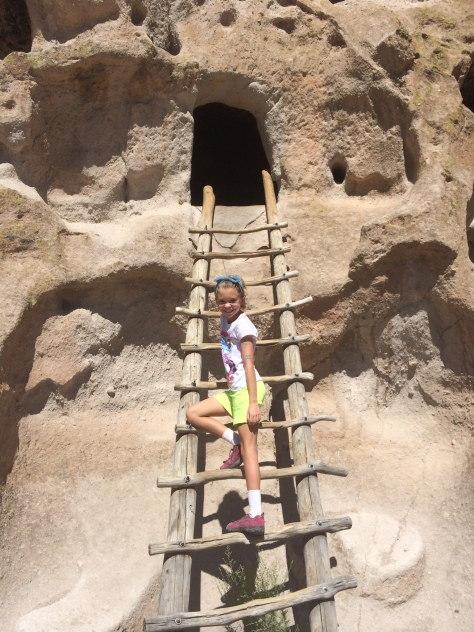 Little Coyote (Zia's daughter) climbs up into a cavate.